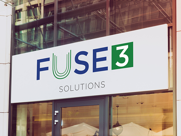 Sign with Fuse3 Solutions logo above a door